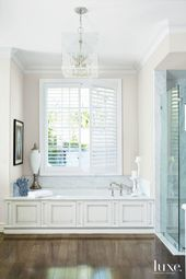 Traditional White Master Bathroom with Sunken Tub