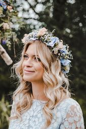 Bridal hairstyle: open, long hair with slight waves, plus a hair ring with blue …