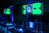 Technology themed Bar Mitzvah. Techy Beatz logo centerpiece. Hi tech centerpiece & LED tables. Illuminated centerpiece & tables. The Event Of A Lifeit…