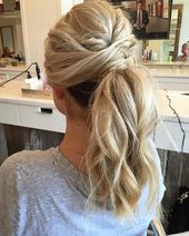 Twisted and messy ponytail by Gabi at The Bride Bar.