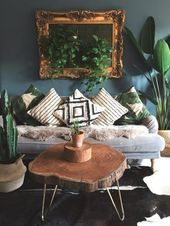 This neutral living room is asymmetrical because the pictures are so … #asymmetric