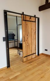 Photo of Sliding door in rustic wood