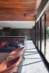 Modernes Einfamilienhaus mit künstlerischer Fassadengestaltung mit stahlverzierenden Ideen   – Grob-House