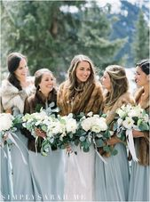Beautiful bride with her bridesmaids at her winter destination wedding on Lake l…