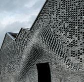Bricklaying robots create bulging masonry facade at Shanghai arts centre