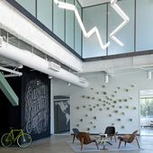majestic office coffee bar. The Silicon Valley HQ of data storage company Evernote features a coffee bar  in the lobby staircases with built seating and an house artist