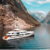Beautiful mountains view with the luxury yacht. #yachtcharter #yachting #charter…
