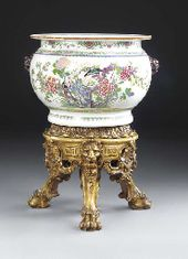 A large porcelain bowl on a giltwood stand