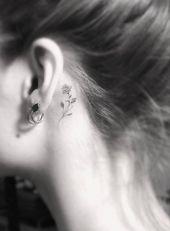 filigree tattoo-motive-behind-ear rose