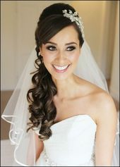 Bridal hairstyle with veil, half open and worn on the side WOMAN …