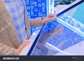 Woman Hand Using Interactive Touchscreen Display Stock Photo (Edit Now) 1550111126