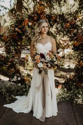 This fall bride wore an elegant strapless wedding dress with lacey details for h…
