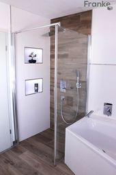 Badezimmer in einer modernen holzoptik moderne badezimmer von elmar franke fliesenlegermeisterbetrieb e.k. modern fliesen