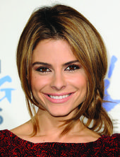 Maria Menounos' playful side bun. Easy hairdo for those lazy days.