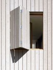Modern wood clad window shutter | White-stained larch cladding covers window ope…   – Tiny Houses