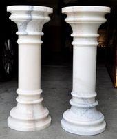 Pair of white marble pedestals