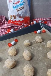 Photo of Children's chocolate biscuits in cookie dough – baking with chocolate candies