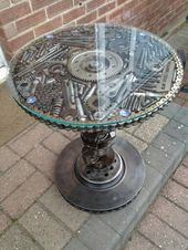 Petrol head tables made from recycled materials.