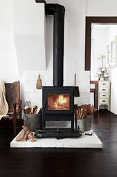 wood burning stove with white brick rustic modern …
