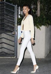 Zendaya, cream jacket, white lace top, sleek pony, tight white high waisted pant…