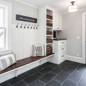 We love fresh look of this black and white mudroom…