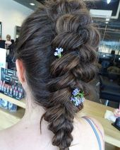 This messy style has a pretty remarkable braided crown that turns into a much larger braid. These styles are very cool and would be great for an event