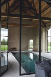 gorgeous indoor swimming pool in restored stone fa…