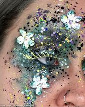 Make-up artist covers her eyes in REAL flowers and it's incredible