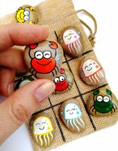 Tic tac toe sport with crabs and jellyfish, Hand painted stones, Pure magnificence toy