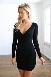 2cdc26dc61666 sexy black long sleeved fitted cleavage dress