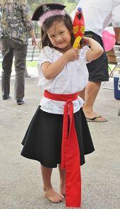 little girl pirate costume – black skirt we have, white shirt, red belt