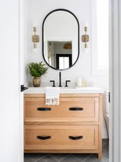 We finally did it. Ha! This powder room, located r…