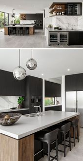 This modern kitchen, which is divided into two area, has the main kitchen with a large island, while adjacent to it, is a wet bar with storage for gla…