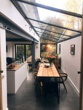 Industrial modern kitchen and dining room with ceiling windows and wooden details –