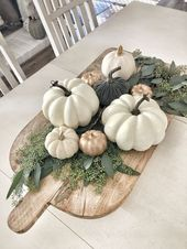 Easy fall centerpiece using wood pizza board; fresh seeded eucalyptus, and white…