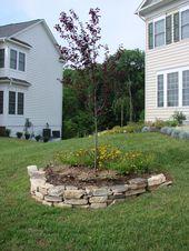 Cool sloped garden ideas. #boxwoodlandscapefrontyard #cottagelandscapefrontyard