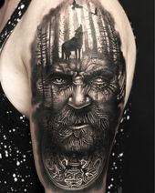 3D tattoo on the upper arm Odin Viking god Wolf in the forest and two ravens