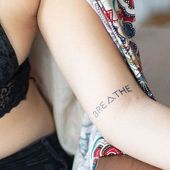 BREATHE by inkbox is a Quotes temporary tattoo from inkbox