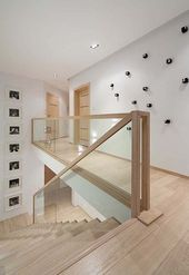 Black and white interior with wood accents in Poland: D24 House #wood accents #hou