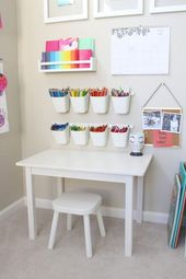 Baby playroom ideas with box and white table and chairs also photo on the wall