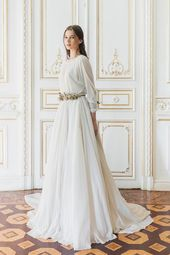 Long sleeve wedding gown with removable lace slip