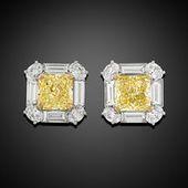 An extraordinary pair of Fancy Intense Yellow diam…