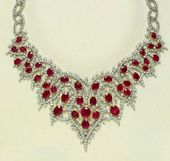 A RUBY AND DIAMOND NECKALCE, BY ELIE CHATILA. A n…