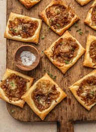 These Caramelized Onion Puff Pastry Tarts are made with flaky pastry, topped with caramelized onion and brie cheese.Your new go-to appetizer for the upcoming holiday season!