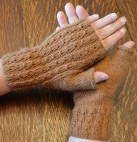 These fingerless mitts knit up quick with fingering weight yarn. The pair shown are made were made from locally raised and spun alpaca fiber.