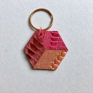 Red and fuchsia Hexagon bag charm made from ostrich skin
