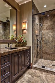 """In the mountains of North Carolina is this eye-catching mountain resort bathroom. Features include custom designed cabinetry in a a grey wood stain with charcoal glaze; Magic Brown granite in the shower; and this wall finish is actually a wallcovering, however the designer suggests a great substation if you wish to emulate this look: Benjamin Moore """"Revere Pewter"""" HC-172."""