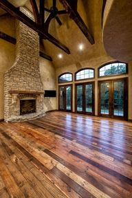 Barn wood floors. beautiful. I love the different colors in the wood! Big open room!