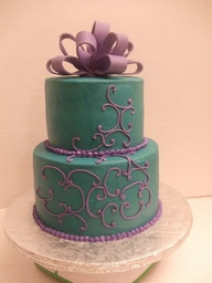 teal cake with lavender piping