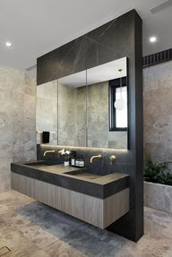 Nailing lighting layouts and designs can be tricky, especially in bathrooms. Using both overhead and lighting around the mirror helps eliminate shadows and can even help create a moody ambience.